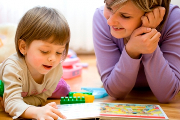 Mother and child having fun while teaching and playing together